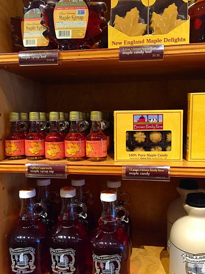 Bottles of maple syrup on a shelf in a Vermont store