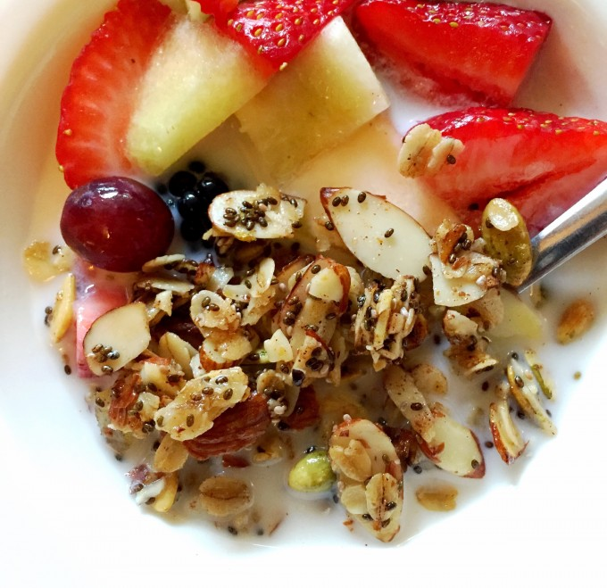 Skillet granola in a bowl with fruit and milk
