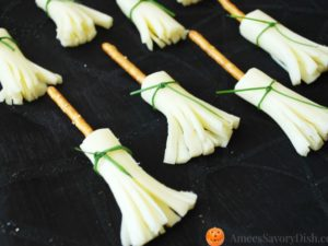 Witches brooms made with pretzels for a healthy Halloween snack