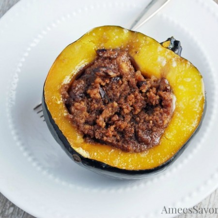 Stuffed acorn squash in a bowl with a fork