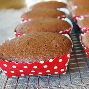 Freshly baked gingerbread loaves in red polka dot baking pans