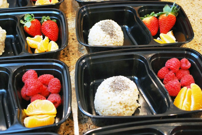 Meal prep containers with oats, chia seeds and fresh fruit inside