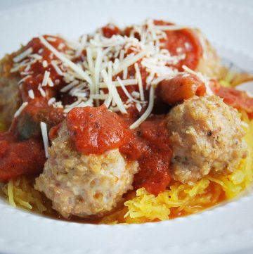 meatballs over a bed of spaghetti squash topped with marinara and shredded cheese