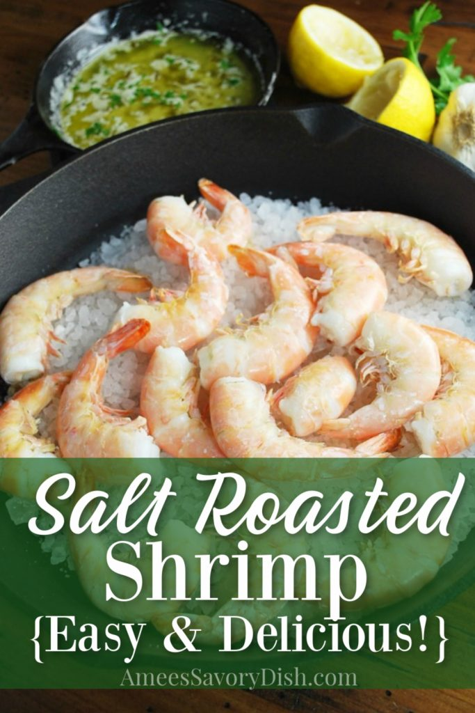 Skillet of salt roasted shrimp with butter sauce and lemon in the background