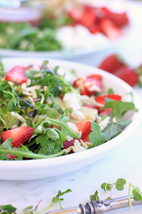 Strawberry and mixed green salad in a bowl