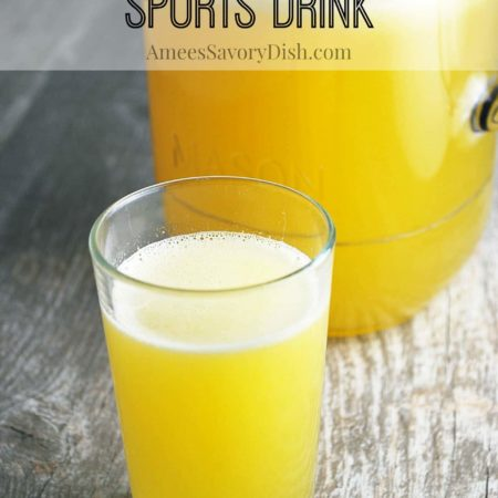 Homemade Gatorade in a glass with a pitcher in the background