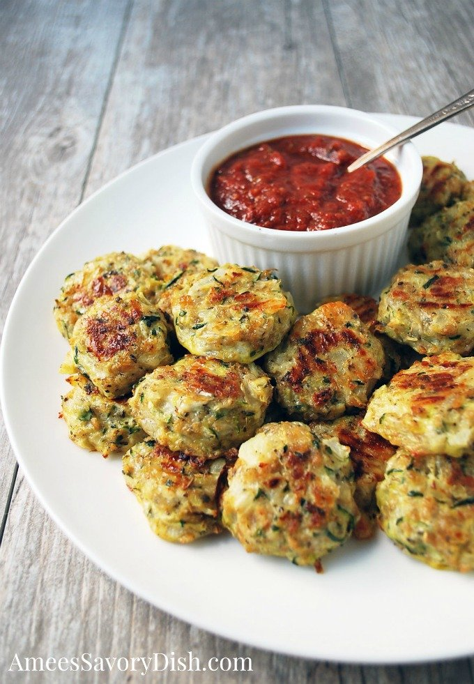Zucchini Tots on a plate with dipping sauce