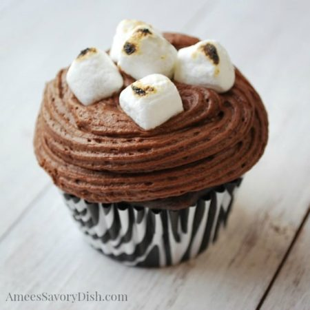 Close up of a smores cupcake with burnt mini marshmallows on top