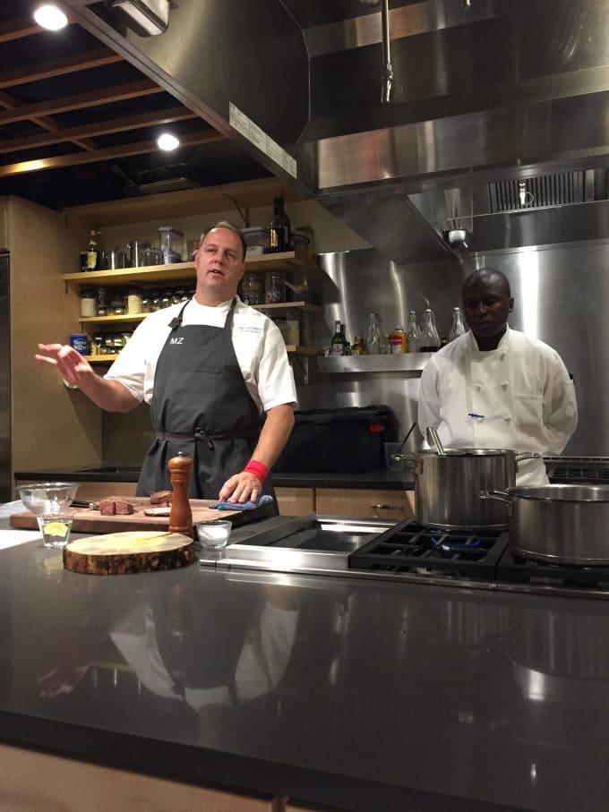 A man in a kitchen preparing food