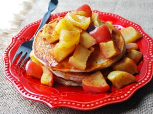 Greek yogurt pancakes on a plate with apples and fork