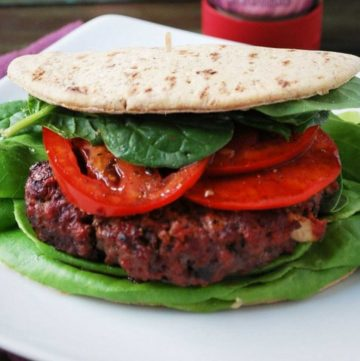 burger with lettuce, spinach and a flatbread wrap