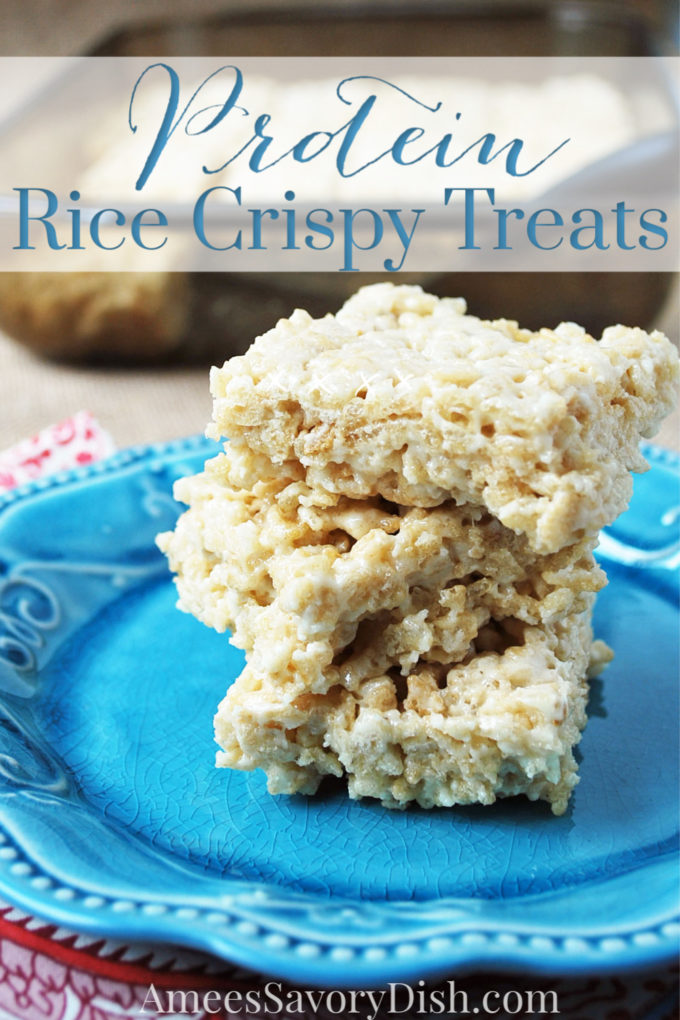 stack of protein rice crispy treats on a blue plate