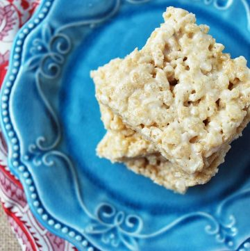 stack of rice krispy treat squares on a blue plate