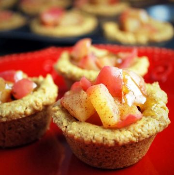 peanut butter tarts filled with cooked apples on a red plate