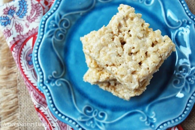 Protein Rice Crispy Treats on a plate with napkin underneath