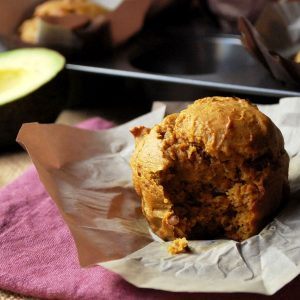 avocado pumpkin muffin with a bite taken out of it