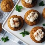 sweet potato muffins on a platter topped with melted marshmallows and cinnammon