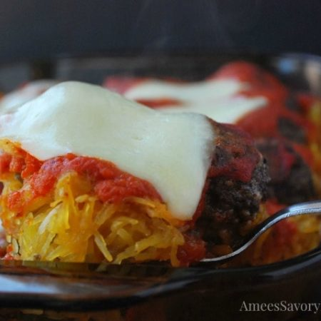 A close up of a spoonful of meatball casserole with spaghetti squash