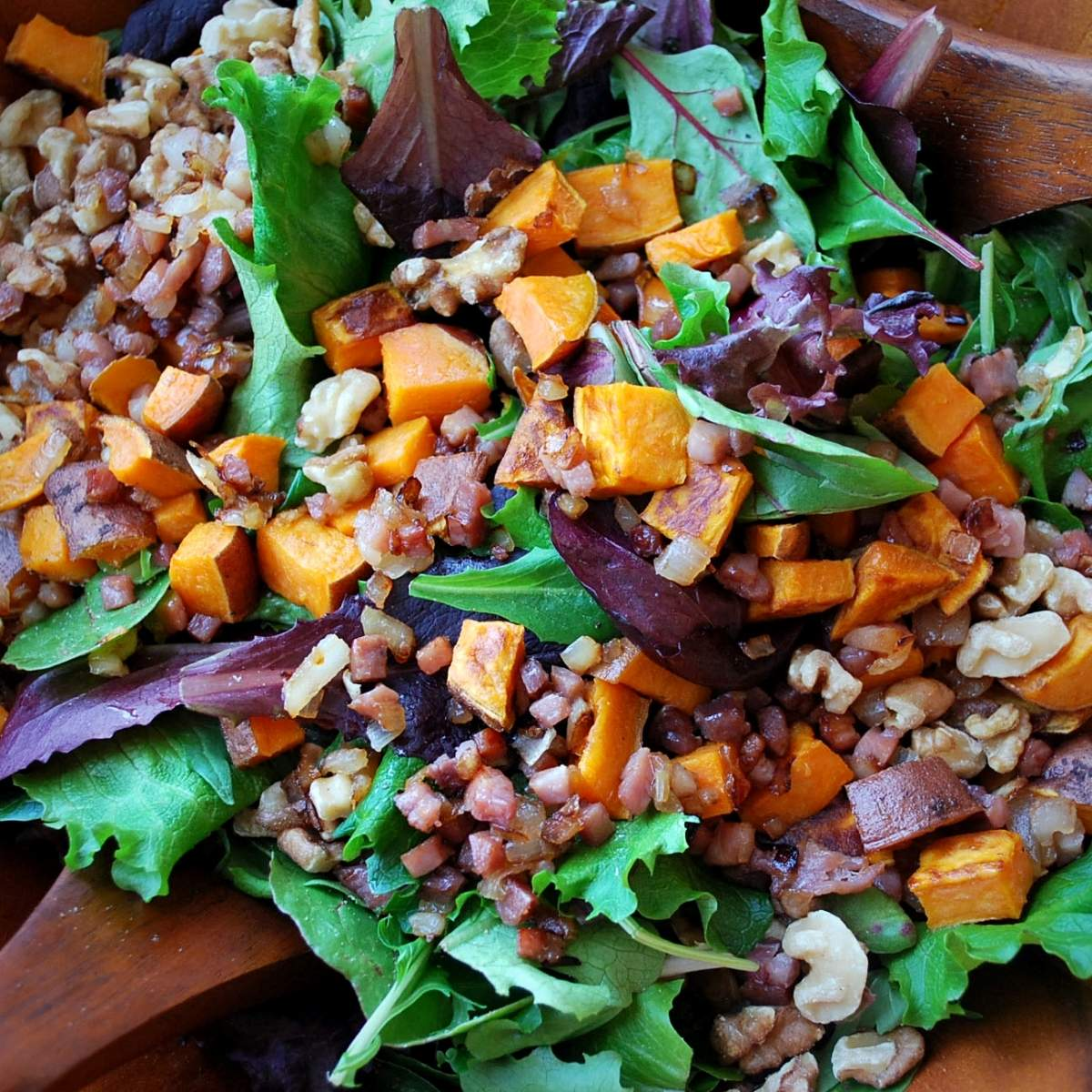 This delicious roasted sweet potato salad is the perfect combination of flavor and texture with toasted walnuts, goat cheese and a tangy balsamic dressing. via @Ameessavorydish