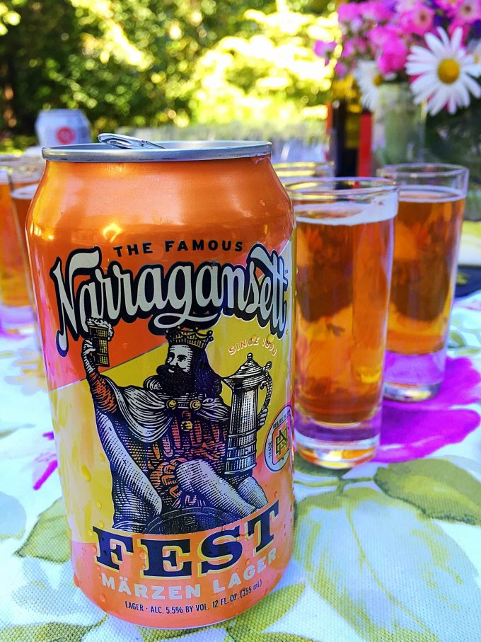 Narragansett beer in a can with glasses of beer in the background