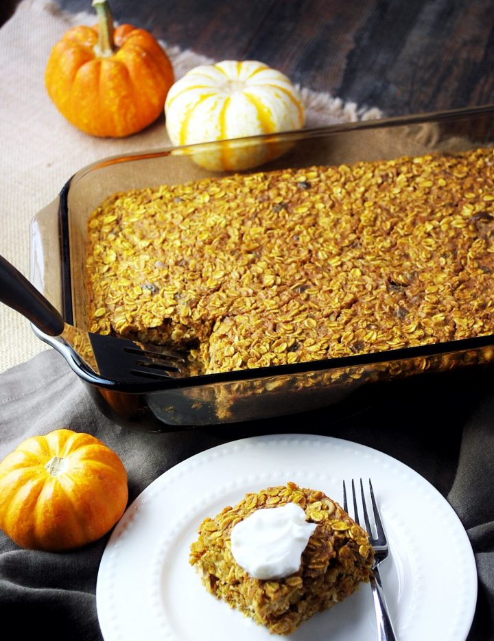 pan of pumpkin oatmeal with a plated serving and fork