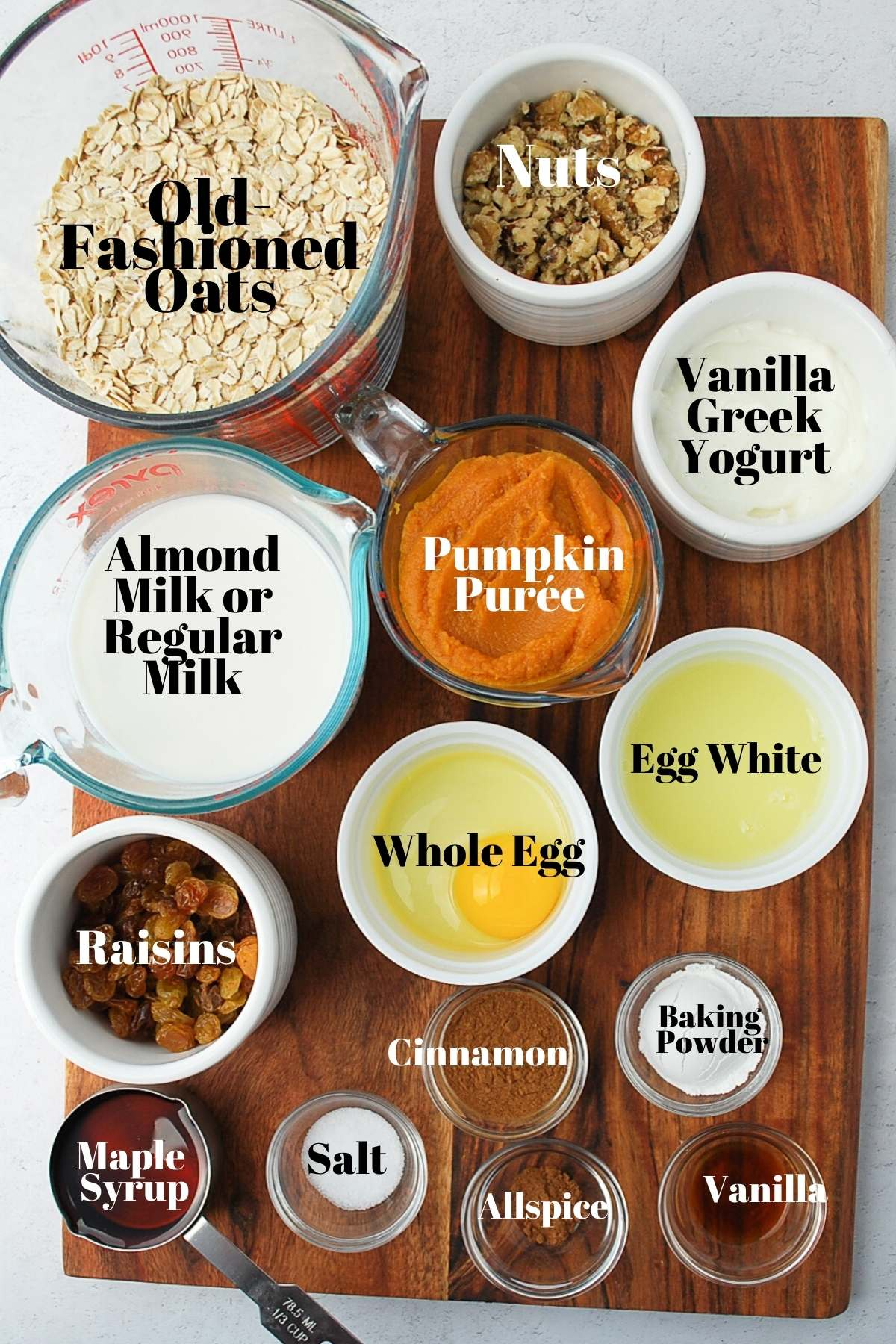 All of the ingredients for pumpkin pie baked oatmeal on a cutting board