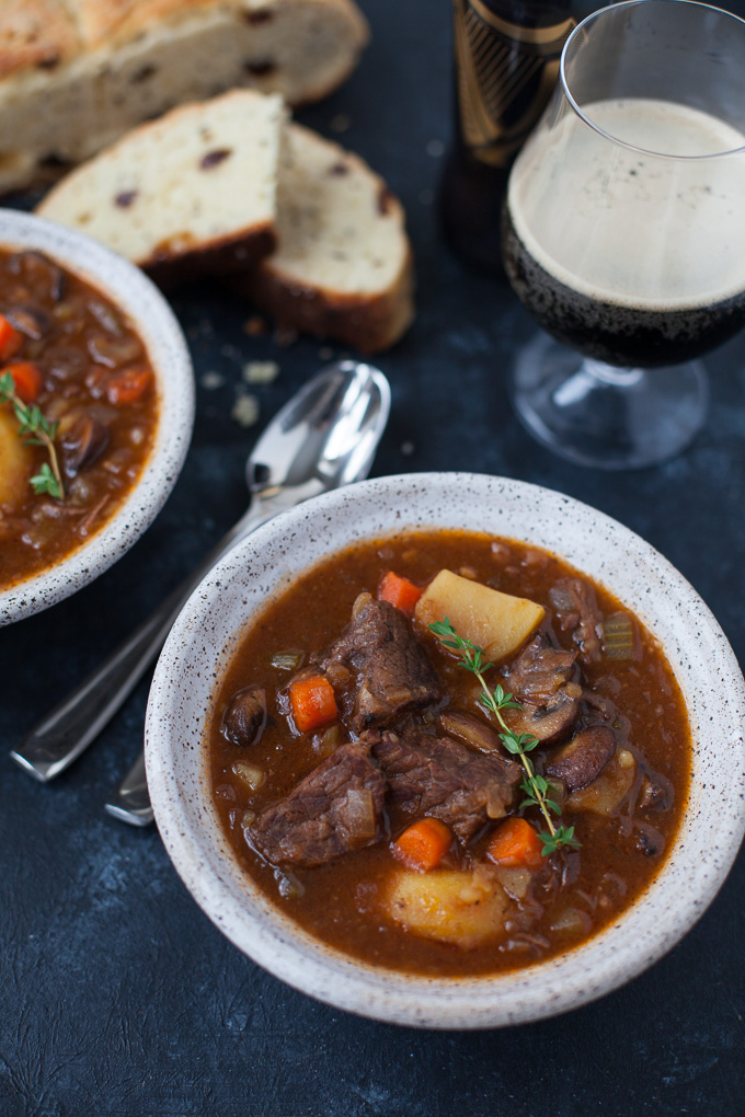 Guinness beef stew in bowls with spoons