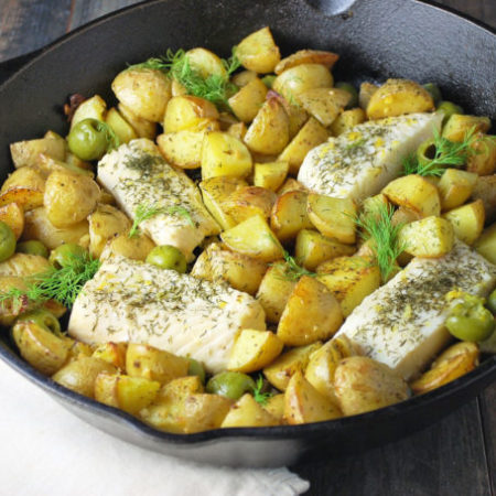 Baked Halibut with Fingerlings and Olives is a mouthwatering one-dish meal made with gold fingerling potatoes, green olives, halibut and dill.