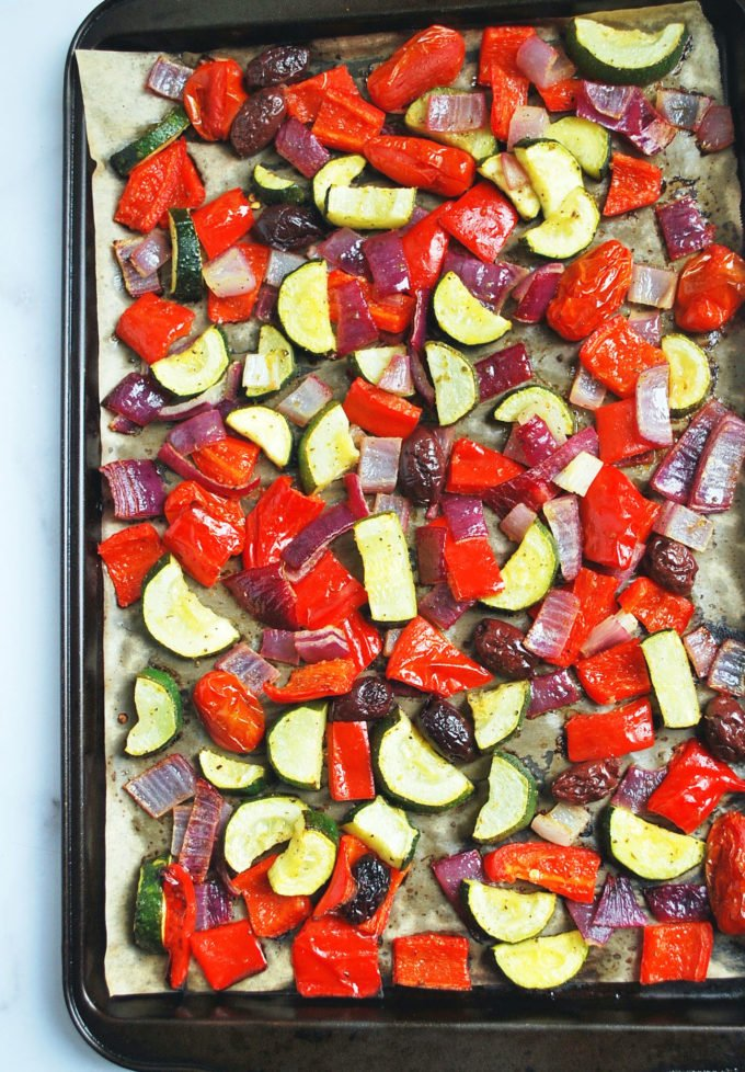 overhead photo of a baking sheet with roasted vegetables