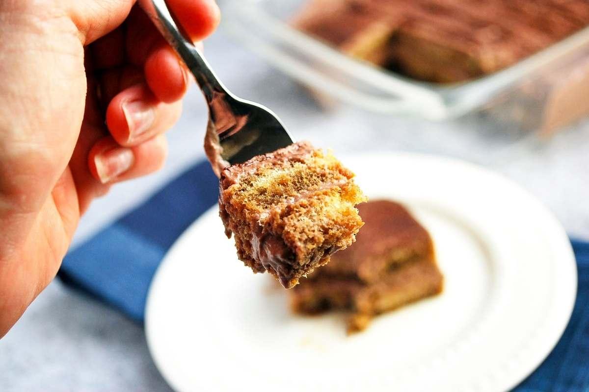 fork with a bite of protein tiramisu on it