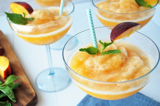 An easy recipe for peach frosé made with Rosé wine and fresh peaches