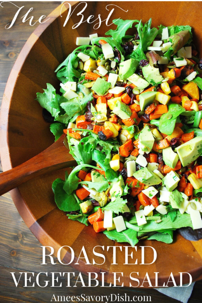 Roasted vegetable salad in a wooden bowl with spoon
