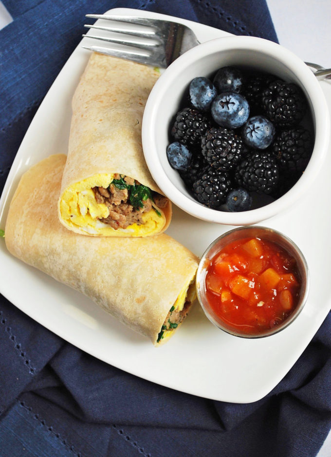 breakfast burritos for meal prep with fresh berries and salsa