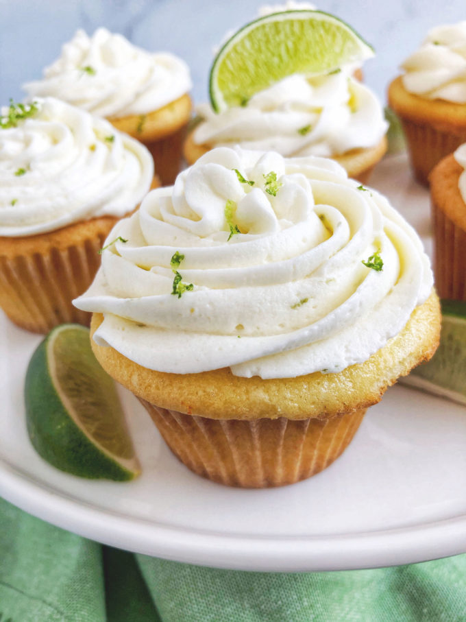 Close up of a key lime cupcake with fresh zest