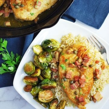 plate of chicken piccata with brussels sprouts