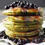 stack of matcha protein pancakes with blueberries on top