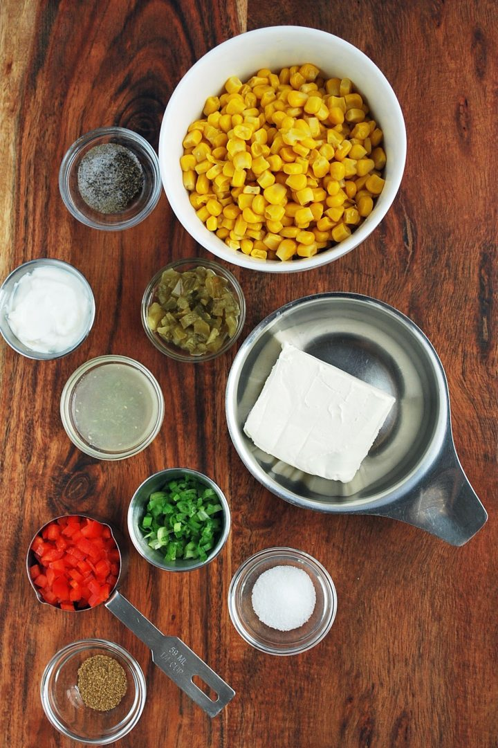 ingredients for corn relish dip on a wooden cutting board