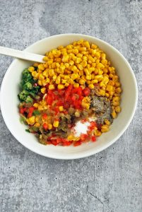 Corn relish dip ingredients mixed in a bowl