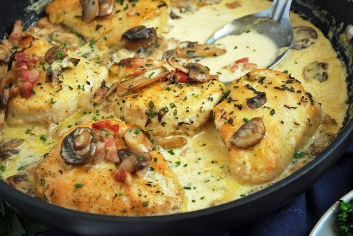 pan of tarragon chicken made with whole chicken breasts in a skillet
