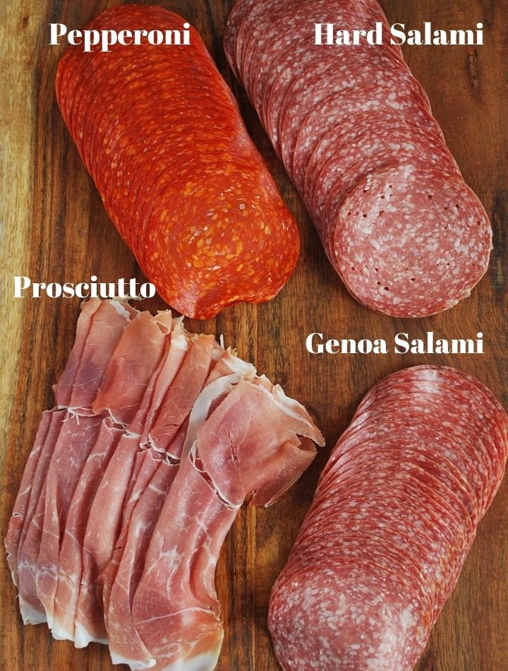 4 different Italian meats on a cutting board