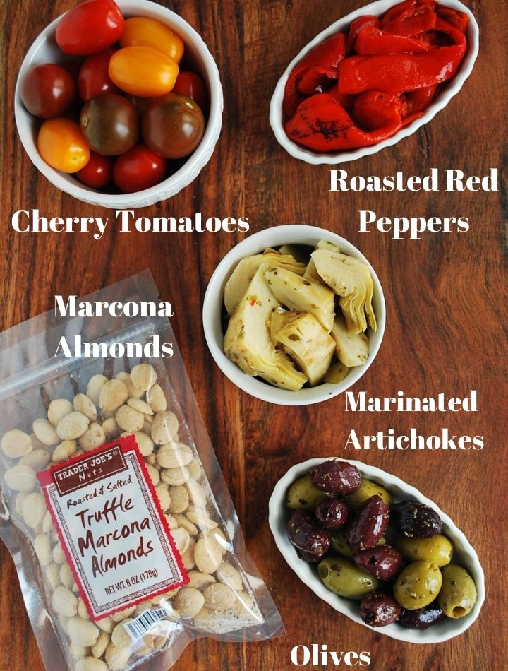 savory ingredients for charcuterie platter on a cutting board