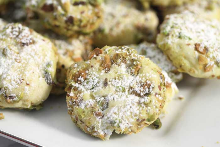 pistachio whipped shortbread cookies on a plate