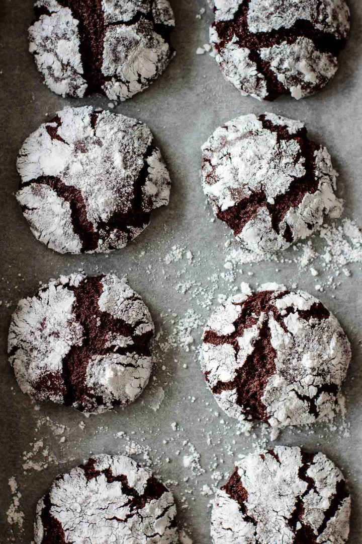 chocolate ginger crinkle cookies on parchment paper