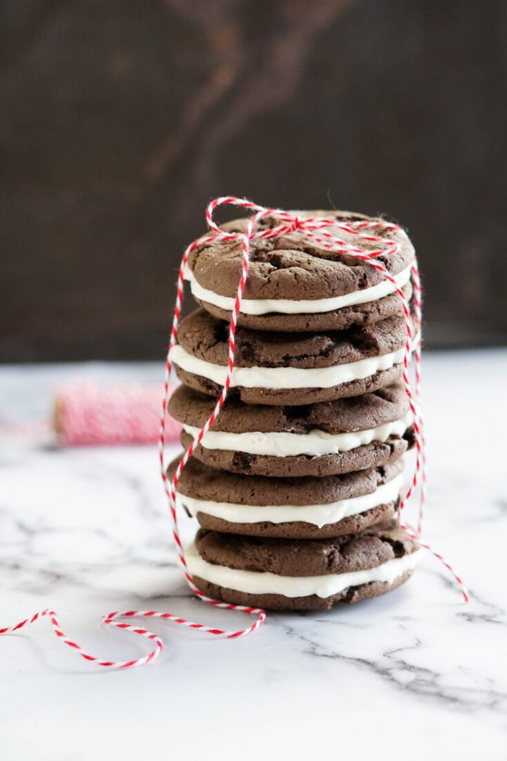 homemade oreos stacked with a ribbon tied around them