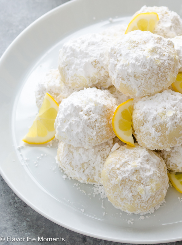 lemon cookies dusted with powdered sugar on a plate
