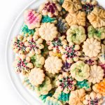 cardamom spritz cookies decorated with sprinkles on a platter