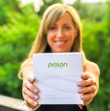 Woman holding a box of ProLon FMD