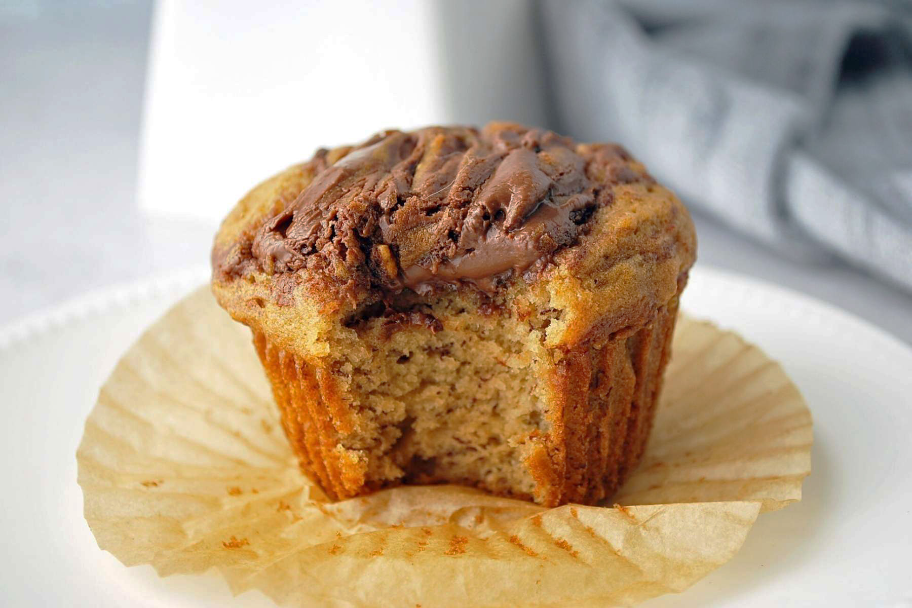 muffin with a bite taken out of it on a counter