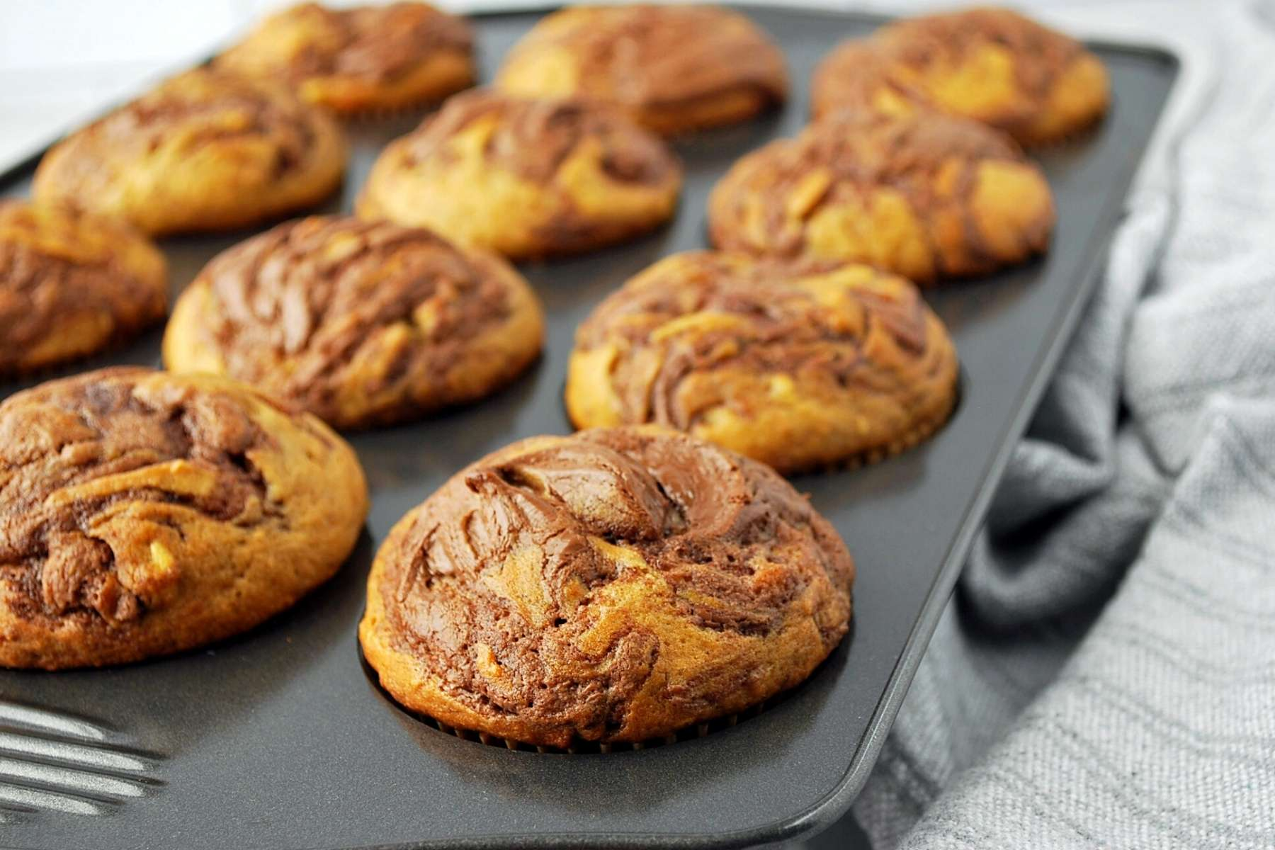 banana nutella muffins freshly baked in a muffin pan