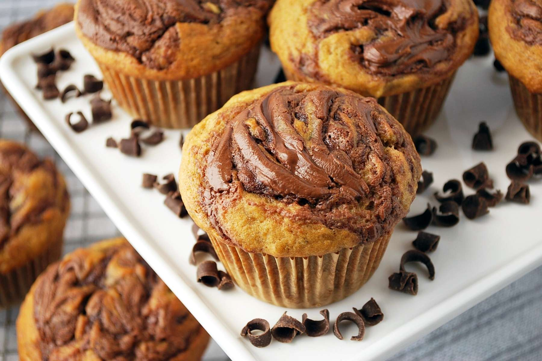 close up shot of a banana muffin with swirled Nutella on top